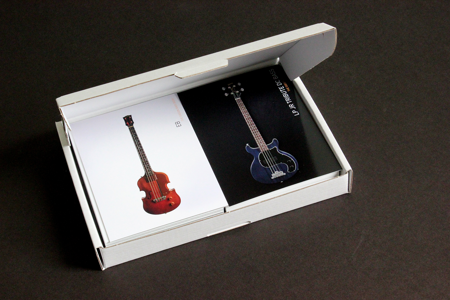 Box with 100 Gibson Bass Book postcards open